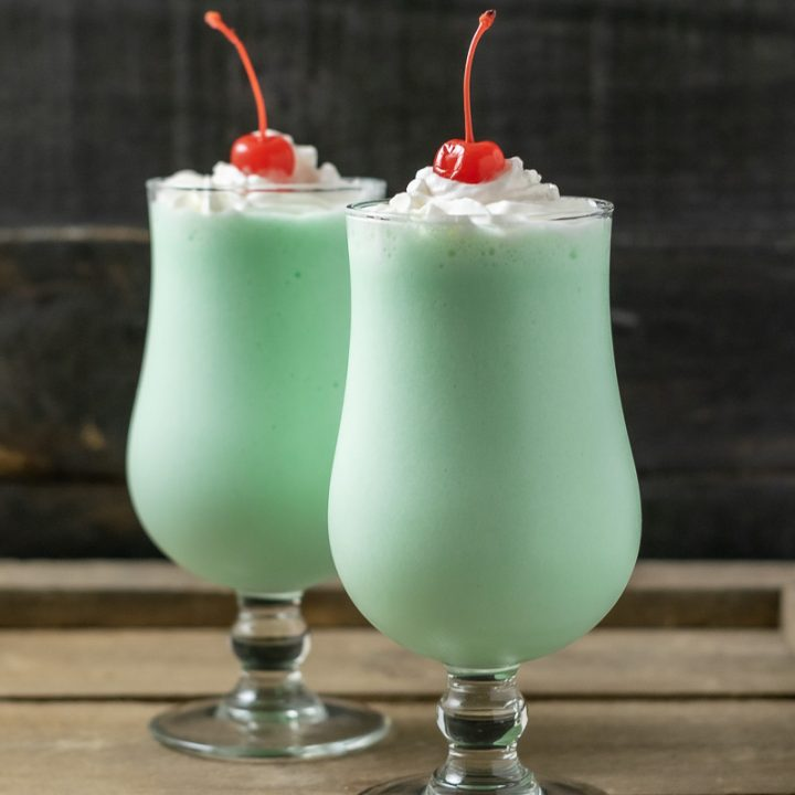 two green shamrock shakes on a tray