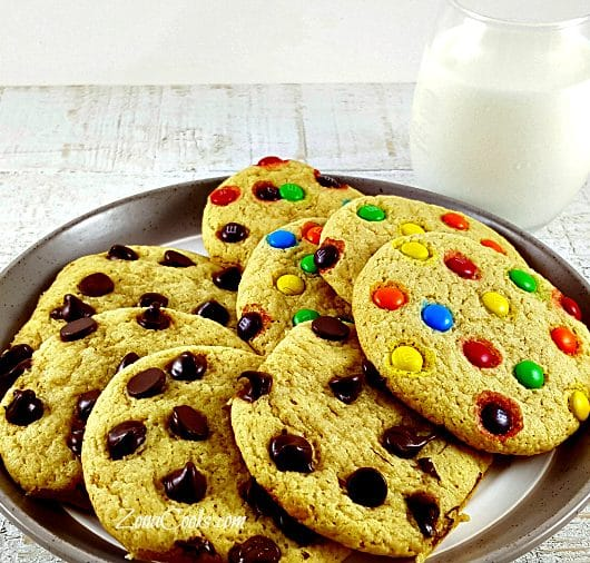 8 soft batch cookies on a plate and a glass of milk
