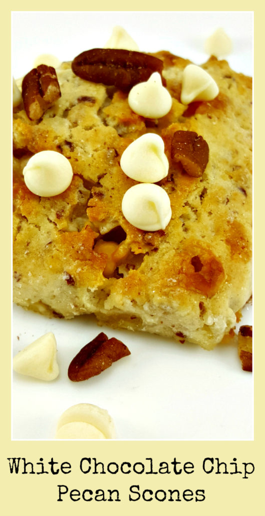 a scone topped with white chocolate chips and pecans and a text box saying White Chocolate Chip Pecan Scones