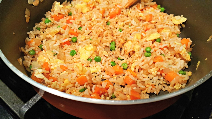 homemade fried rice cooking in a pan