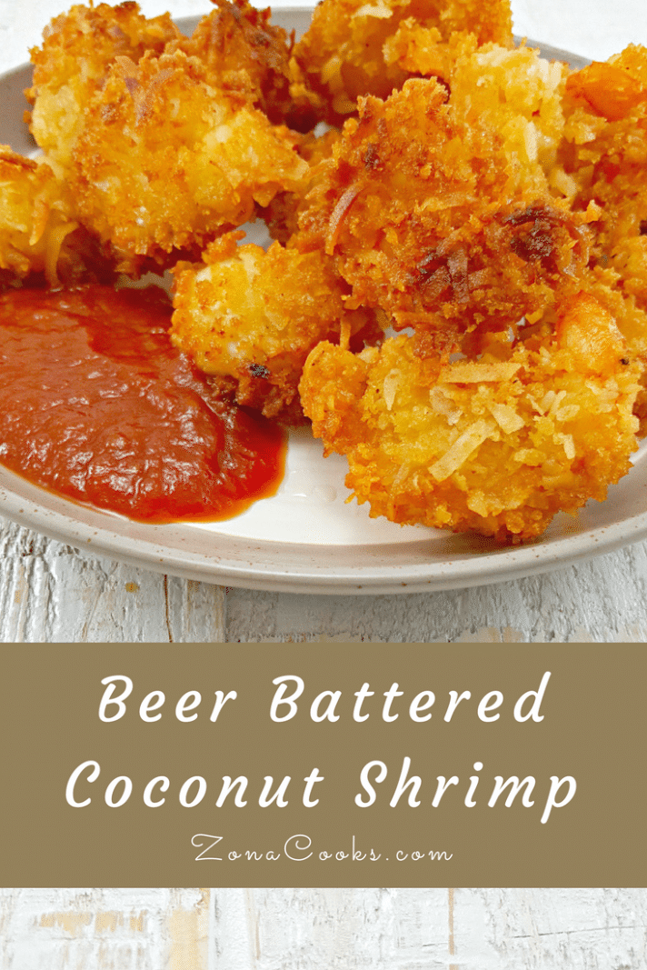 Beer Battered Coconut Shrimp on a plate with cocktail sauce and a text box saying Beer Battered Coconut Shrimp
