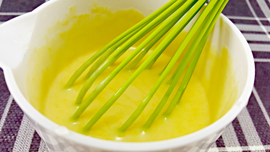 egg yolks, sweetened condensed milk and lime juice and whisked together in a bowl with whisk