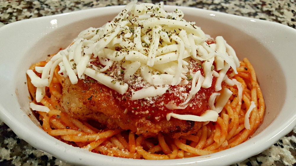 Chicken Parmesan Recipe for Two - top with cheese and basil
