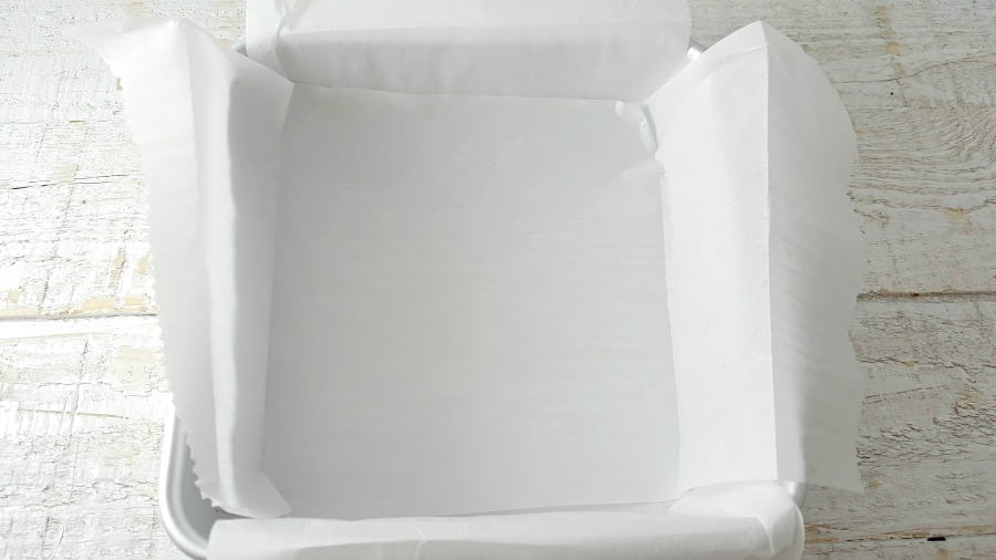 baking pan with parchement paper overlapped inside it