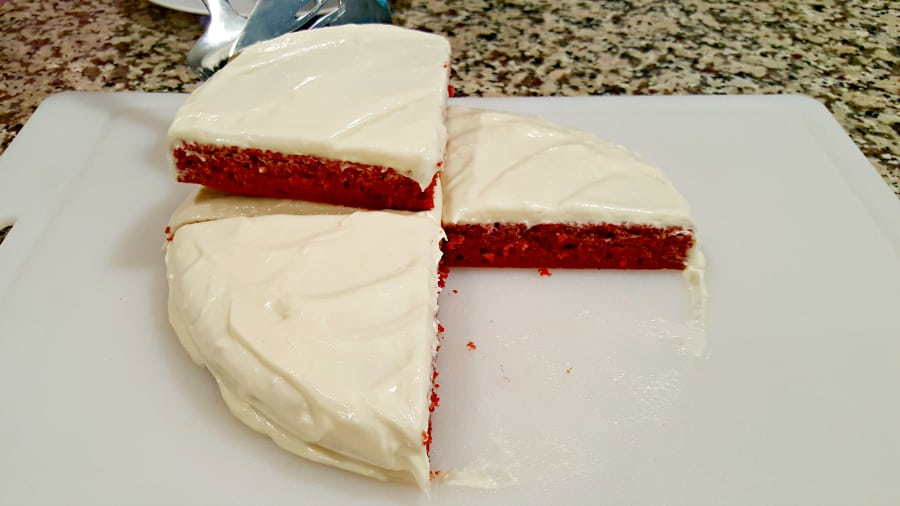 Red Velvet Cake and Whipped Cream Cheese Frosting for Two - layer first piece of cake