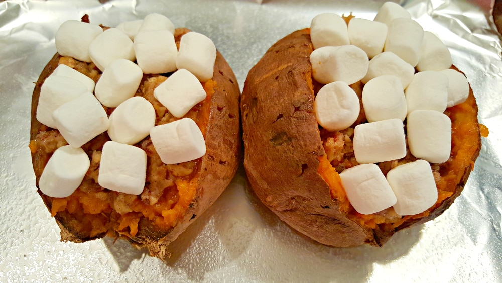 two sweet potatoes stuffed and topped with marshmallows