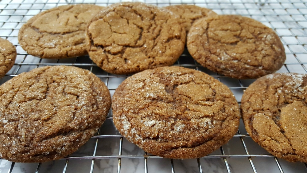 8 gingerbread molasses cookies on a cooling rack