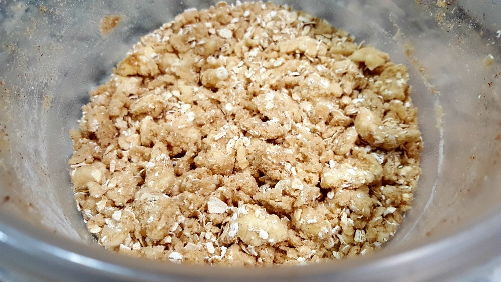 crumbly topping mixture in a glass bowl