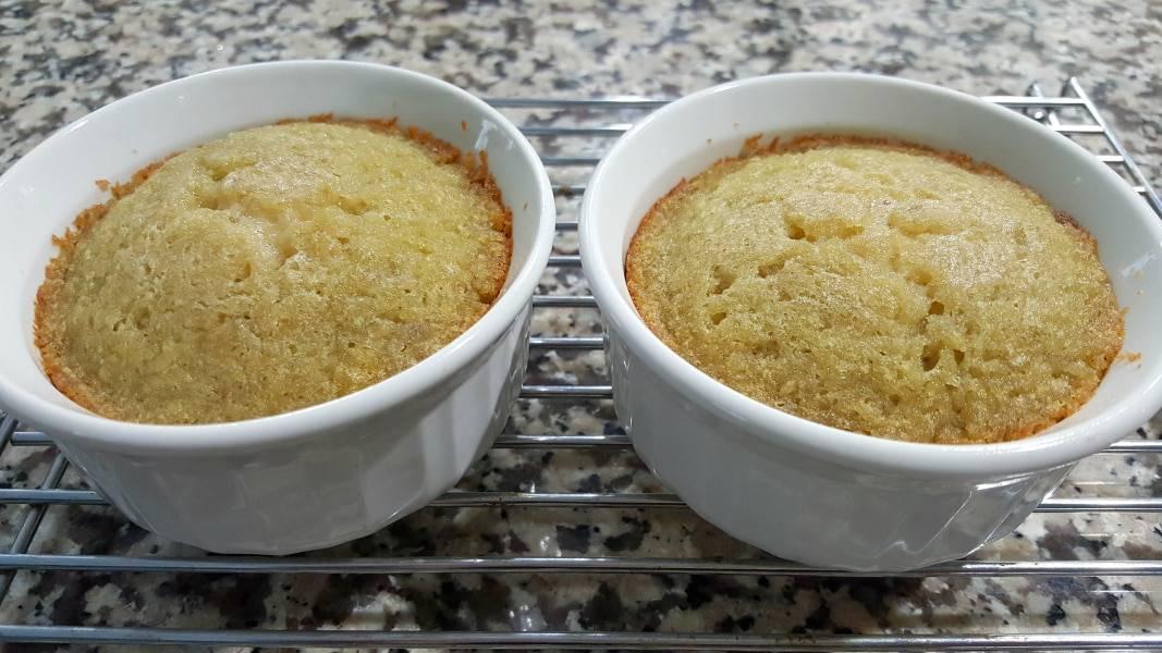 two yellow banana cakes in ramekin dishes