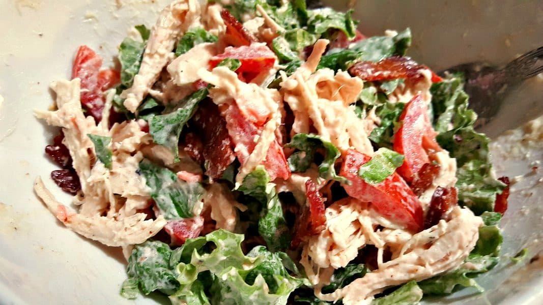 chicken blt salad filling ingredients mixed together in a bowl