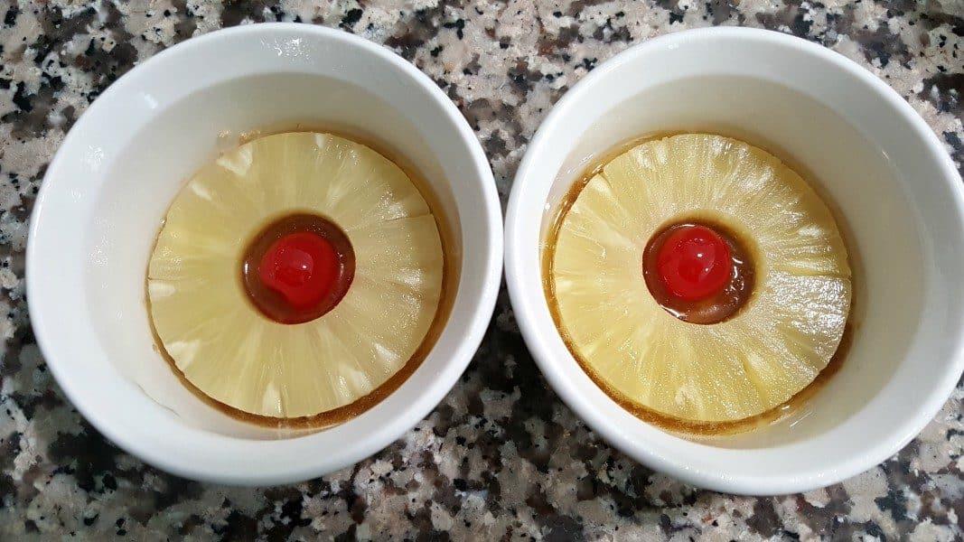 pineapple rings and cherries in two ramekins