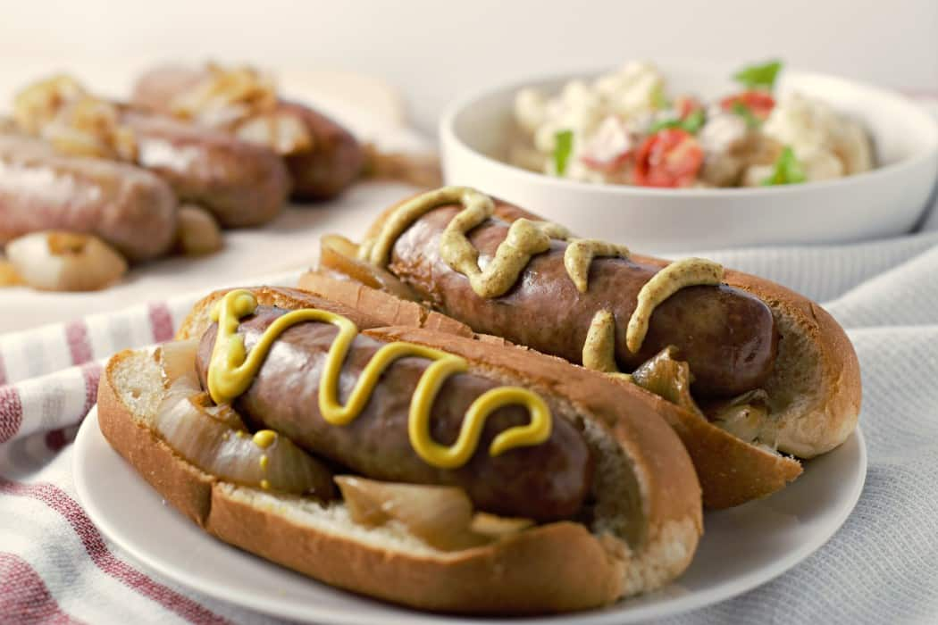Beer Brats and Caramelized Onions with a side dish.