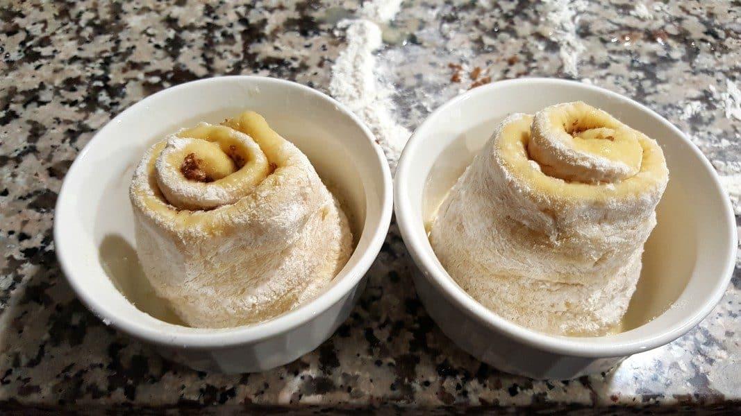 uncooked cinnamon rolls in two ramkeins