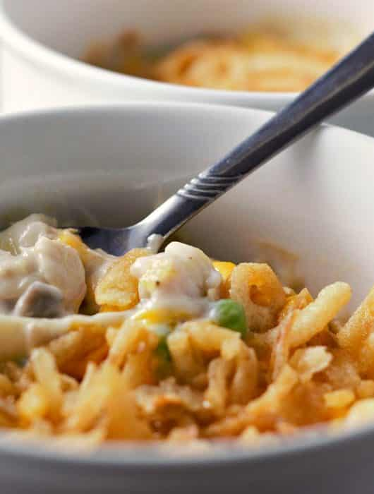 a close of view of tuna casserole with a spoon scooping some up