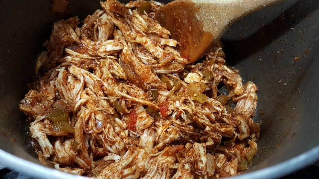 shredded chicken, salsa, brown sugar, spices, and liquid smoke mixed together and cooking in a sauce pan