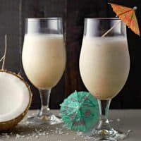 Two Pina Coladas in stemmed beer glasses