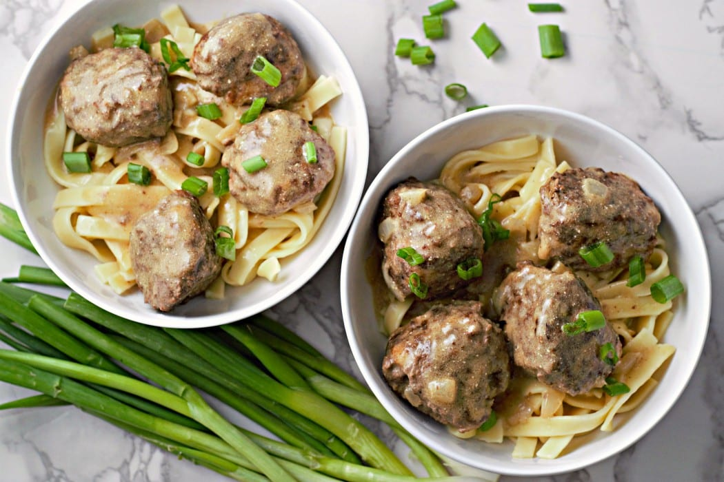 Homemade Swedish Meatballs with Egg noodles topped with green onion