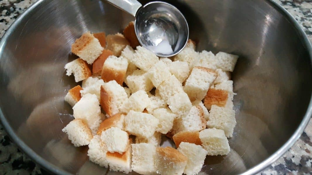 cubed bread and milk in a mixing bowl
