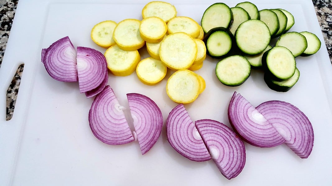 sliced zucchini, sliced yellow squash, and sliced red onions