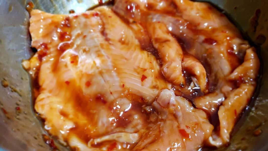salmon marinating in sweet chili sauce marinade
