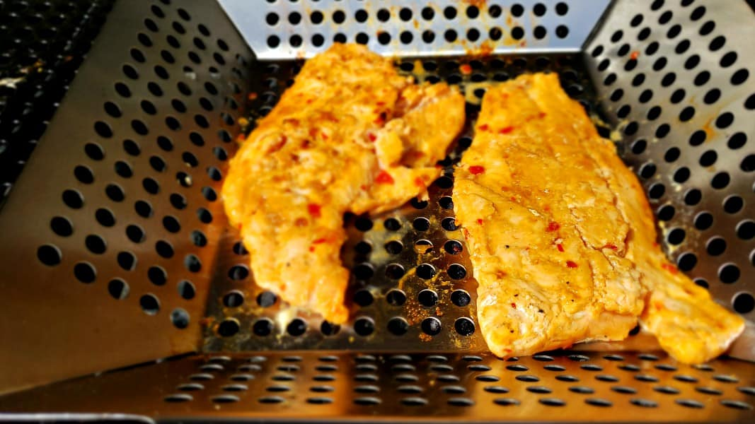 second side of salmon grilling with sweet chili sauce marinade