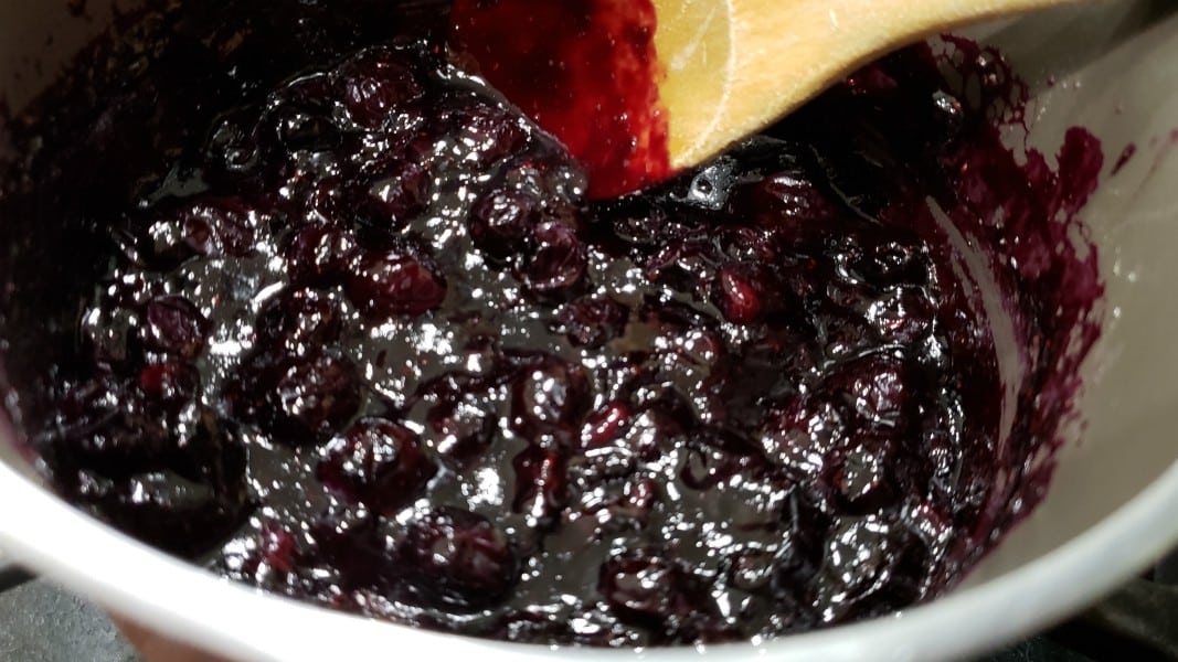 blueberry sauce cooking in a pan