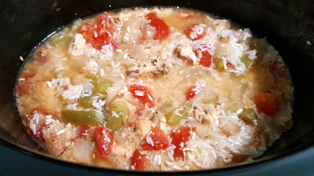 rice added to Jambalaya ingredients in a slow cooker