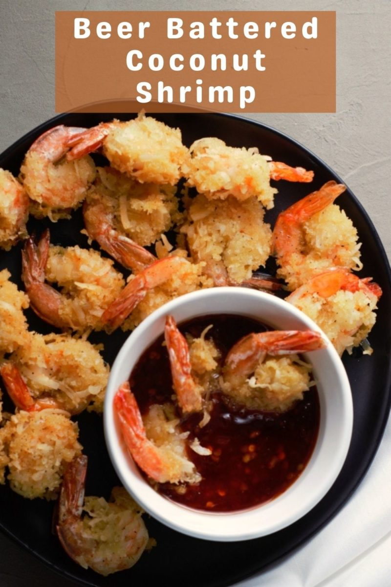 Beer Battered Coconut Shrimp on a plate with a bowl of dipping sauce.