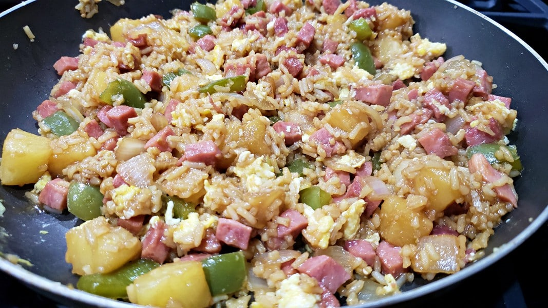 Hawaiian fried rice cooking in a pan