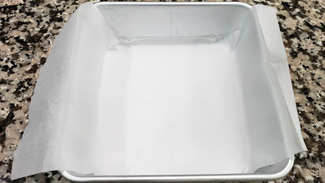 a small cake pan lined with parchment paper