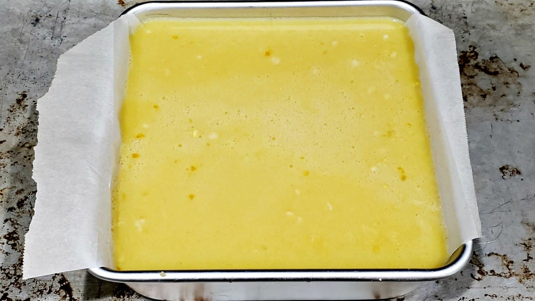 lemon filling poured into cake pan