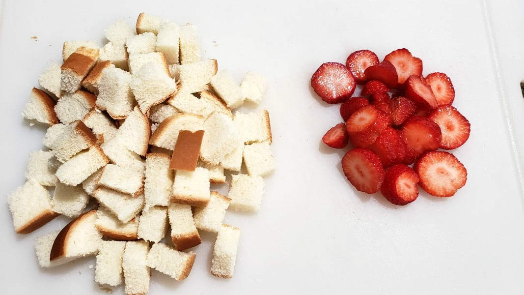 sliced strawberries and cubed bread