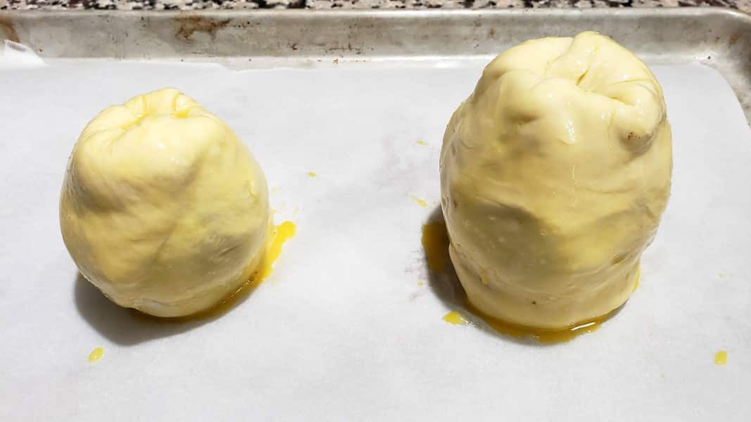 two pears wrapped in puff pastry and brushed with egg wash