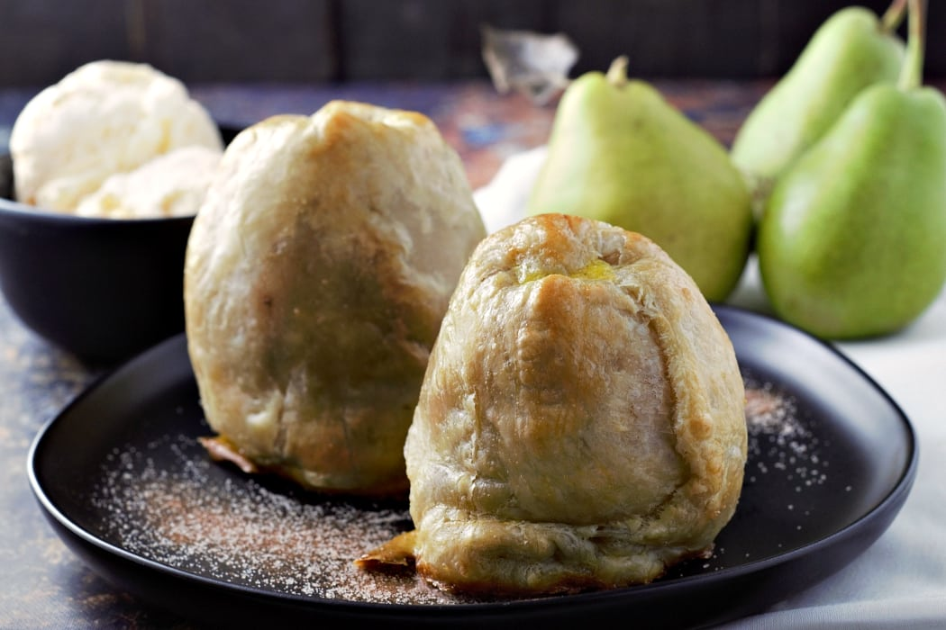 Puff Pastry Cinnamon Baked Pears with ice cream and 3 pears in background