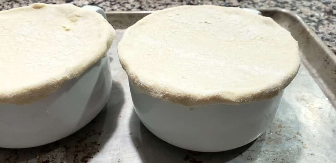 puff pastry circles added to tops of bowls