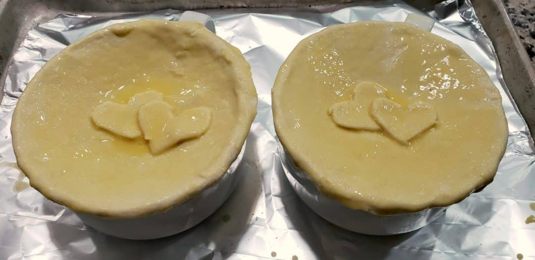 heart shapes added to puff pastry tops and brushed with egg wash