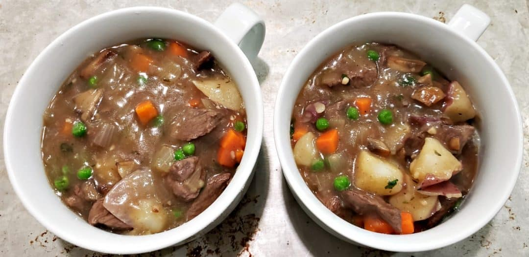 beef stew poured into to bowls