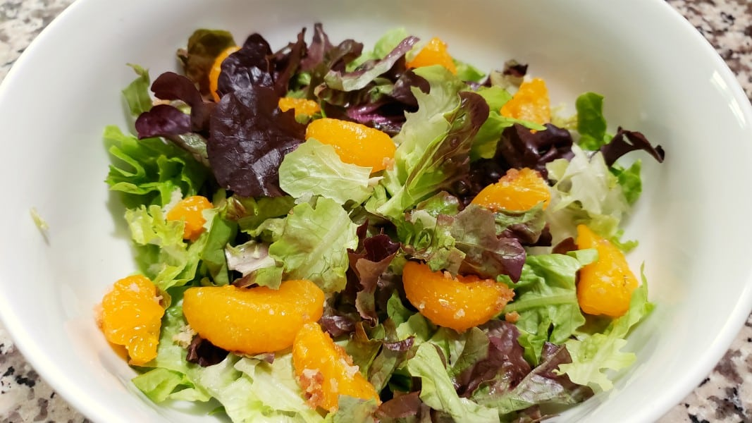 lettuce and oranges in a bowl