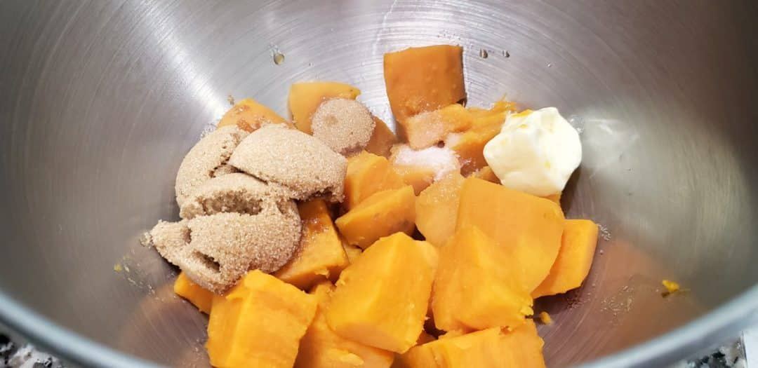 cubed sweet potatoes, brown sugar, butter, salt, and vanilla in a bowl