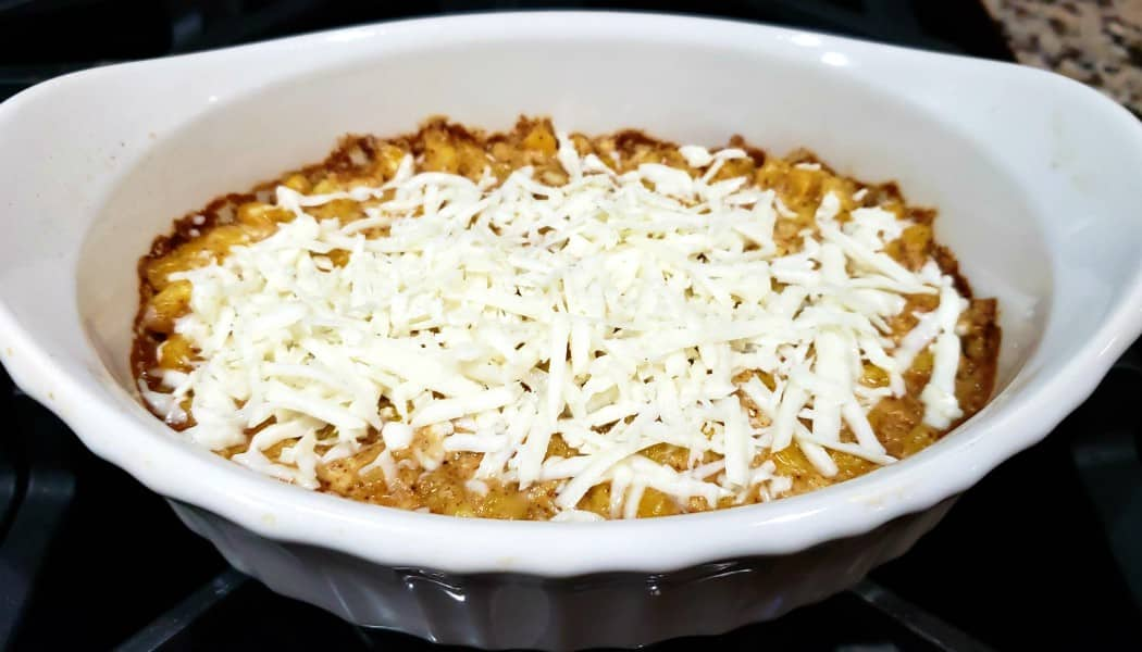 mexican street corn casserole baked and topped with shredded cheese