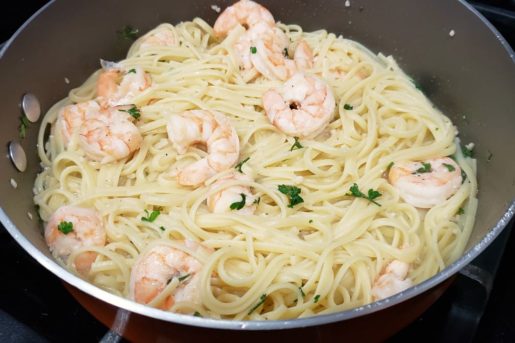 linguine added to the pan with the shrimp scampi