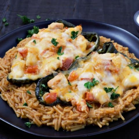 Chicken Cheese Stuffed Poblano Peppers with rice and sour cream