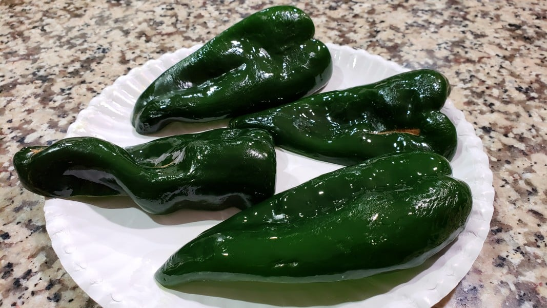 4 poblano pepper halves with skin side oiled