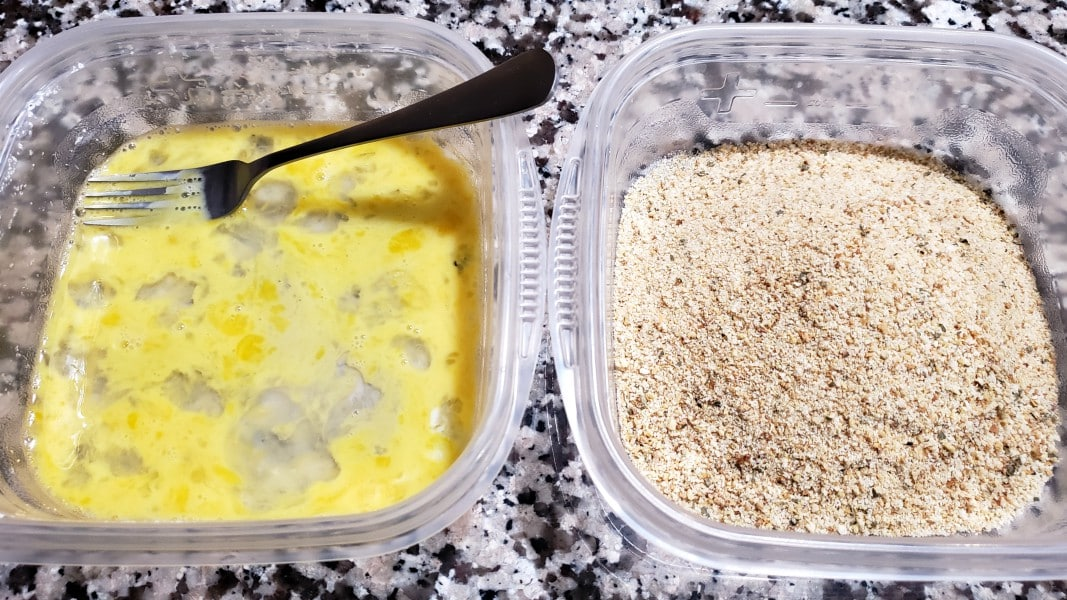 a dish with beaten egg and a dish with seasoned breadcrumbs