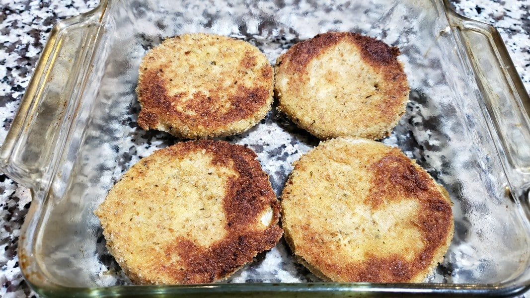 4 fried eggplant slices in a baking dish