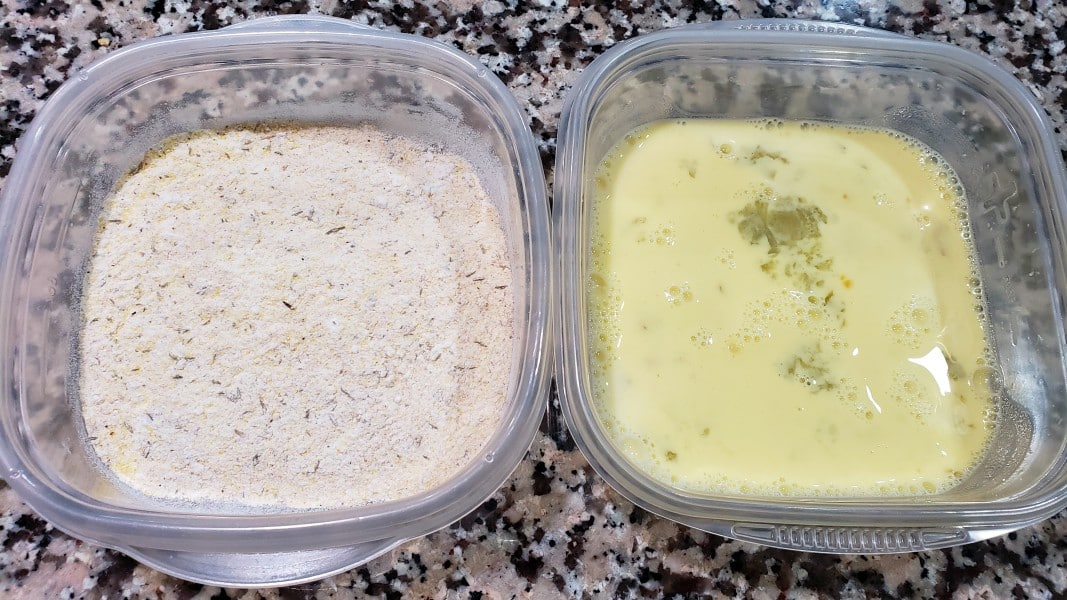 one bowl with breading mixture, one bowl with egg and milk mixture