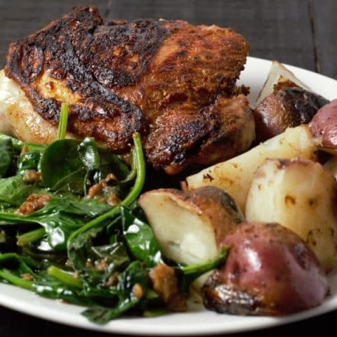 Skillet Crispy Chicken Thighs With Potatoes and Spinach