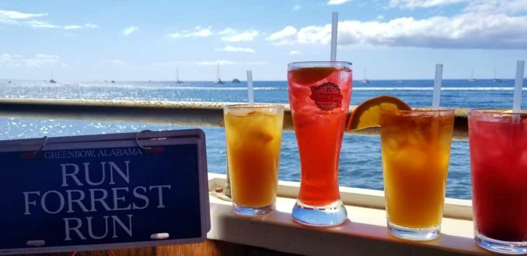 4 tropical drinks with an ocean back drop at Bubba Gump Shrimp Co.