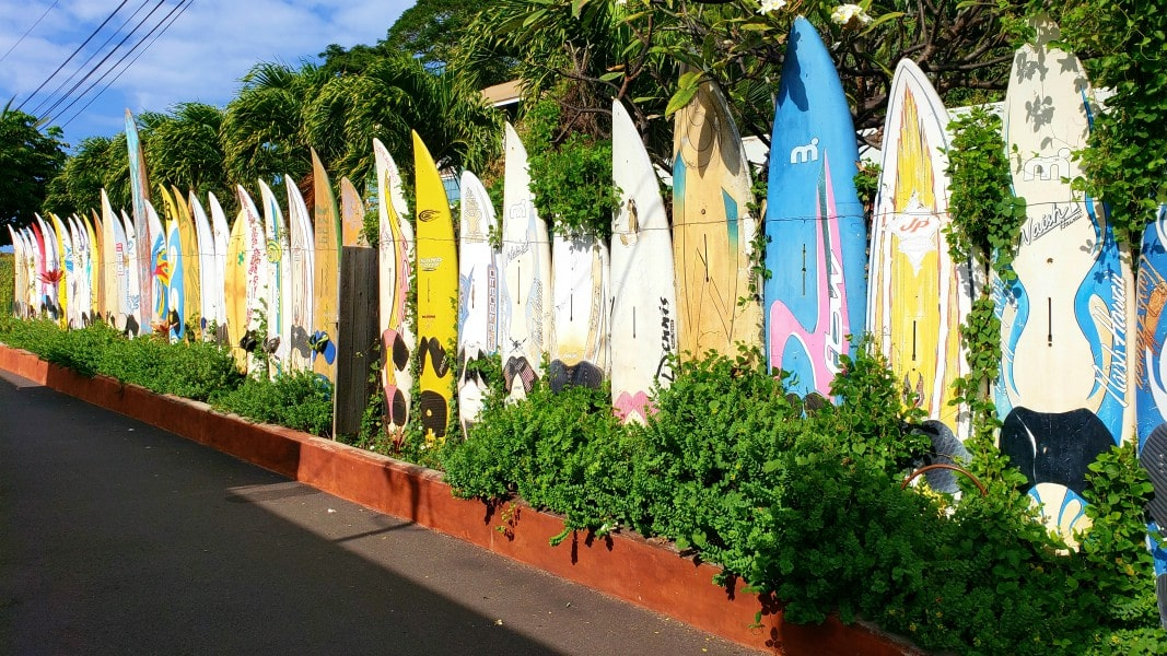 a surf board fence in the town of Paia