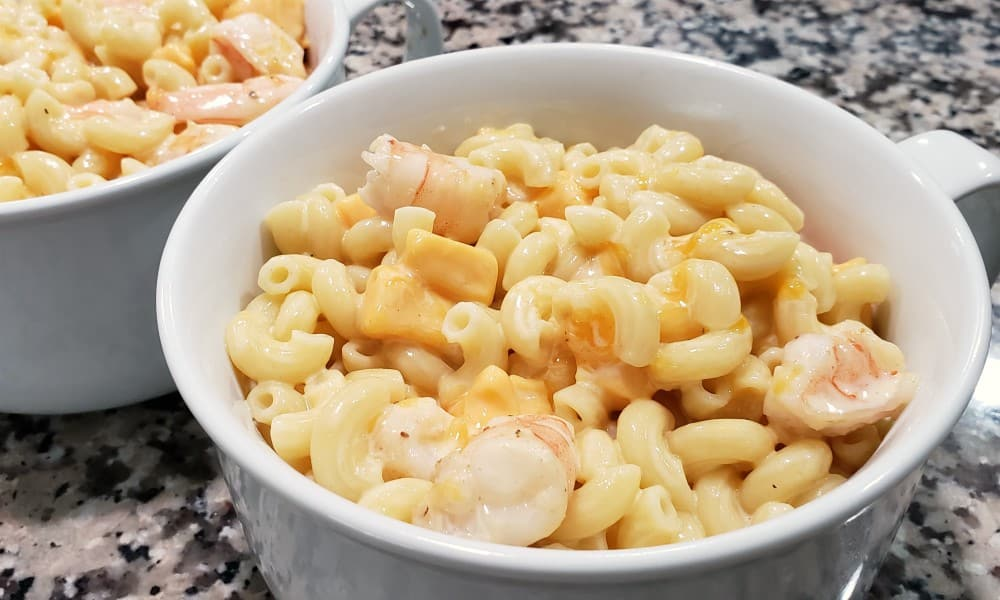 shrimp macaroni and cheese in two baking dishes